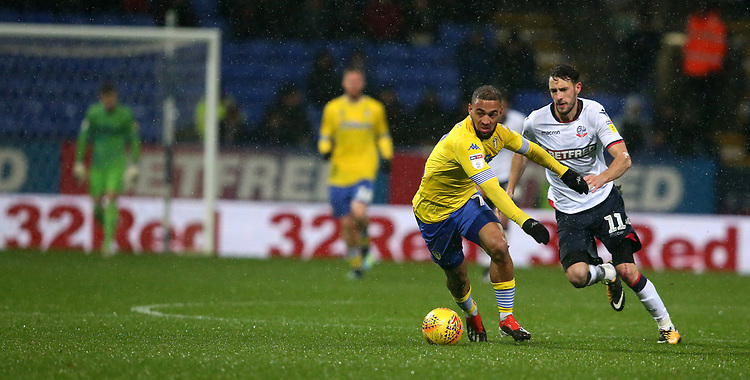 Leeds United's Kemar Roofe and Bolton Wanderers' Will Buckley<br /> <br /> Photographer Stephen White/CameraSport<br /> <br /> The EFL Sky Bet Championship - Bolton Wanderers v Leeds United - Saturday 15th December 2018 - University of Bolton Stadium - Bolton<br /> <br /> World Copyright © 2018 CameraSport. All rights reserved. 43 Linden Ave. Countesthorpe. Leicester. England. LE8 5PG - Tel: +44 (0) 116 277 4147 - admin@camerasport.com - www.camerasport.com