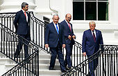 """From left to right: Sheikh Abdullah bin Zayed bin Sultan Al Nahyan, Minister of Foreign Affairs and International Cooperation of the United Arab Emirates; Prime Minister Benjamin Netanyahu of Israel; Dr. Abdullatif bin Rashid Alzayani, Minister of Foreign Affairs, Kingdom of Bahrain; and United States President Donald J. Trump walk down the South Portico steps during a signing ceremony of the """"Abraham Accords"""" on the South Lawn of the White House in Washington, DC on Tuesday, September 15, 2020.   <br /> Credit: Chris Kleponis / Pool via CNP"""
