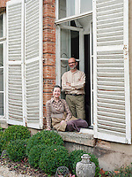 Owners Pascale and Olivier Gisclard in the window of their home in Sezanne