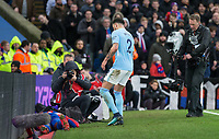 Kyle Walker of Manchester City arrives to help a floored Christian Benteke of Crystal Palace after a challenge between them during the Premier League match between Crystal Palace and Manchester City at Selhurst Park, London, England on 31 December 2017. Photo by Andy Rowland.