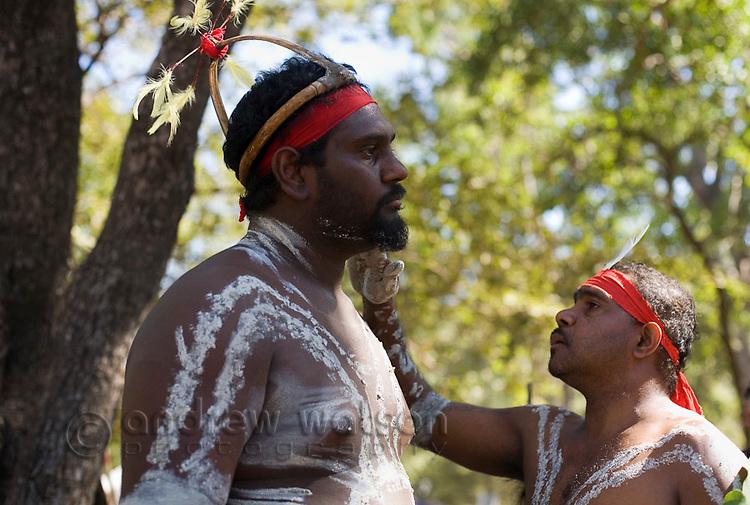 Indigenous dancers applying body paint at the Laura Aboriginal Dance Festival.  Laura, Queensland, Australia