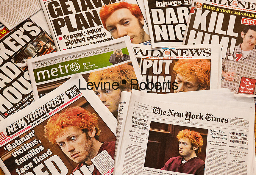 "Several days of July 2012 New York daily newspapers report on the mass shooting during the screening of ""The Dark Knight Rises"" in a theater in Aurora, Colorado, allegedly by 24 year old James Holmes. Twelve people were killed and 58 injured. (© Richard B. Levine)"