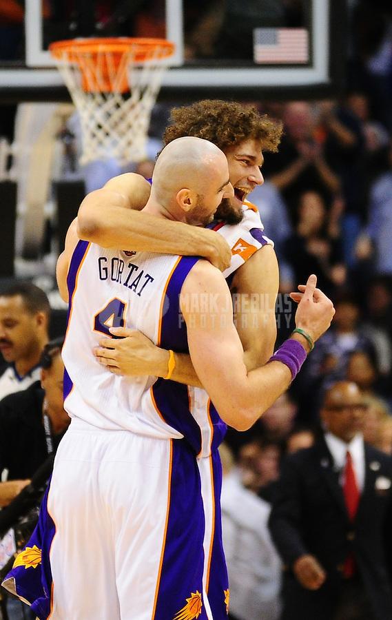 Jan. 28, 2011; Phoenix, AZ, USA; Phoenix Suns forward (4) Marcin Gortat is hugged by center (15) Robin Lopez against the Boston Celtics at the US Airways Center. Mandatory Credit: Mark J. Rebilas-