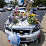 An Illinois State Police car parked outside Waterloo City Hall was turned into a memorial for slain Trooper Nick Hopkins. Dozens of police departments joined in the procession from St. Louis to Waterloo for slain Illinois State Police Trooper Nick Hopkins on Monday August 26, 2019. <br /> Photo by Tim Vizer