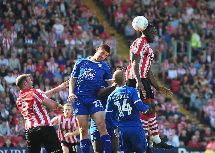 Lincoln City's John Akinde gets above Tranmere Rovers' Evan Gumbs to win a header<br /> <br /> Photographer Andrew Vaughan/CameraSport<br /> <br /> The EFL Sky Bet League Two - Lincoln City v Tranmere Rovers - Monday 22nd April 2019 - Sincil Bank - Lincoln<br /> <br /> World Copyright © 2019 CameraSport. All rights reserved. 43 Linden Ave. Countesthorpe. Leicester. England. LE8 5PG - Tel: +44 (0) 116 277 4147 - admin@camerasport.com - www.camerasport.com