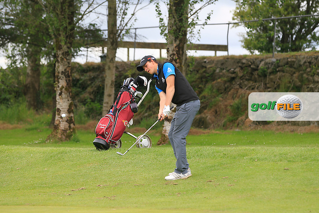 Jamie Knipe (Royal Portrush) chipping onto the 6th green during Round 2 of the Irish Boys Amateur Open Championship at Tuam Golf Club on Wednesday 24th June 2015.<br /> Picture:  Thos Caffrey / www.golffile.ie