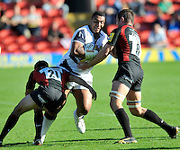 Aviva Premiership Rugby Saracens v Sale Sharks from Vicarage Road, Watford, England. 11th September 2010. Ernst Joubert (Captain) of Saracens and Neil de Kock of Saracens tackle Sisa Koyamaibole of Sale Sharks.