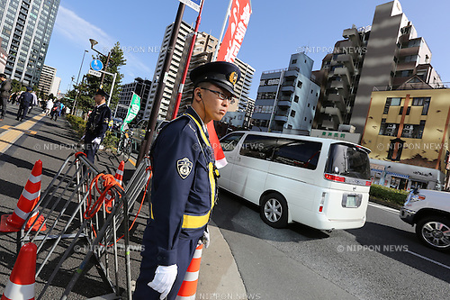 A police officers stands guard during an election campaign by Japan's Prime Minister Shinzo Abe, leader of the ruling Liberal Democratic Party (LDP), in Toyosu, a man-made island in Tokyo, Japan on Sunday, December 7, 2014. (Photo by Yuriko Nakao/AFLO)
