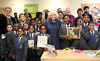 06 February 2019 - Camilla Duchess of Cornwall poses with school children who are holding books that were presents from her to their new library during a visit to St John's Angell Town Church of England Primary School  in London. Photo Credit: ALPR/AdMedia