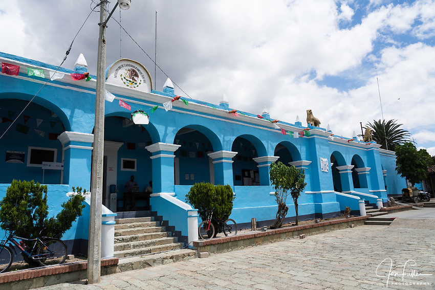 The pastel blue municipal palace or city hall of Tlacochahuaya de Morelos, Mexico.