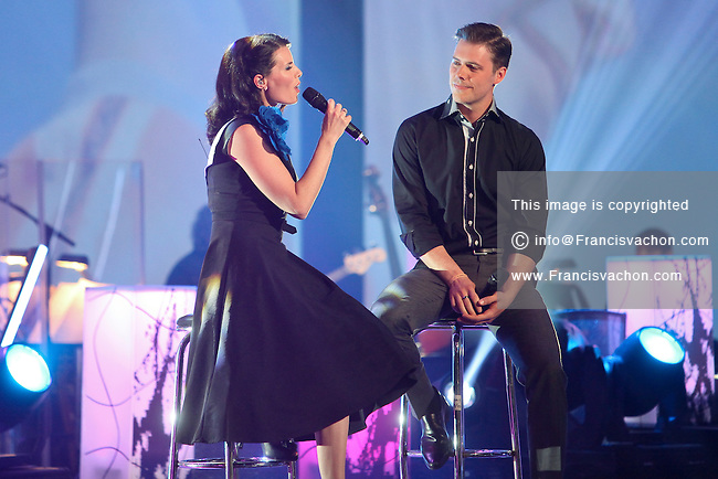 Marie-Eve Janvier and Jean-Francois Breau perform during the Telethon Enfant Soleil in Quebec City Sunday June 3, 2012.
