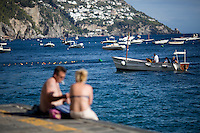 A boat makes its way towards the shore on Sunday, Sept. 20, 2015, in Positano, Italy. (Photo by James Brosher)