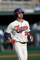 Designated hitter Davis Sharpe (30) of the Clemson Tigers trots to first base in a game against the Charlotte 49ers on Monday, February 18, 2019, at Doug Kingsmore Stadium in Clemson, South Carolina. Clemson won, 7-6. (Tom Priddy/Four Seam Images)