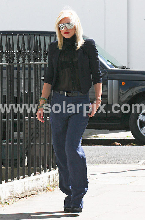 **ALL ROUND PICTURES FROM SOLARPIX.COM**                                             **WORLDWIDE SYNDICATION RIGHTS**                                                                                  Gwen Stefani leaves her home in London and walks down the road to meet husband Gavin Rossdale and sons Kingston and Zuma in a restaurant.                                                                             This pic:    Gwen Stefani                                                                                           JOB REF:    13312    WMB       DATE:   10.05.11                                                         **MUST CREDIT SOLARPIX.COM OR DOUBLE FEE WILL BE CHARGED**                                                                      **MUST AGREE FEE BEFORE ONLINE USAGE**                               **CALL US ON: +34 952 811 768 or LOW RATE FROM UK 0844 617 7637**