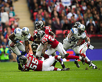 26.10.2014.  London, England.  NFL International Series. Atlanta Falcons versus Detroit Lions.  Lions' WR Jeremy Ross [12] fumbles the ball after a tackle by Falcons' LB Paul Worrilow [55].