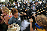 Miami Police officers donned in riot gear advance and fire pepper spray at demonstrators who massed along Biscayne Boulevard protesting the Free Trade Area of the Americas meeting in Miami.