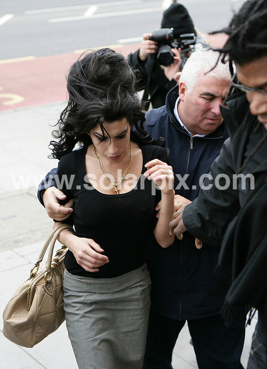 **ALL ROUND PICTURES FROM SOLARPIX.COM**.**NO UK NEWSPAPER PUBLICATION **UK MAGAZINE PUBLICATION ONLY** AND NO PUBLICATION IN FRANCE, SCANDINAVIA, AUSTRALIA AND GERMANY** .Singer  Amy Winehouse pictured at Thames Magistrates Court  in London with her father Mitch this morning where her husband Blake Fielder-Civil was remanded in custody after being charged with attempting to pervert the course of justice..JOB REF: 5311   SFE       DATE:  10.11.07.**MUST CREDIT SOLARPIX.COM OR DOUBLE FEE WILL BE CHARGED* *UNDER NO CIRCUMSTANCES IS THIS IMAGE TO BE REPRODUCED FOR ANY ONLINE EDITION WITHOUT PRIOR PERMISSION*