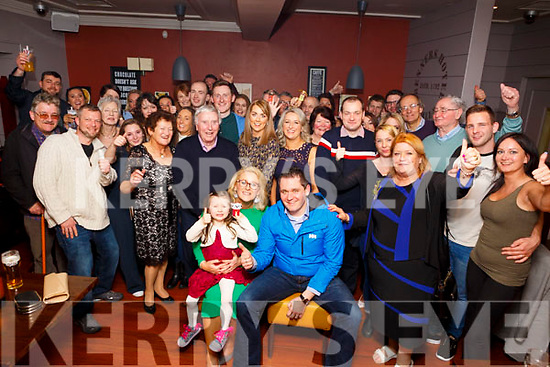 Michelle and James Fairbrother seated, with their family and friends enjoying the after wedding party in Benners Hotel on Sunday evening last.