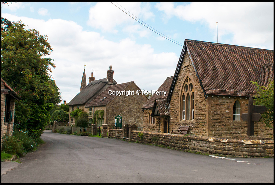 BNPS.co.uk (01202 558833)<br /> Pic: T&JPerry/BNPS<br /> <br /> School corner and the church today.<br /> <br /> The little changed Somerset village of Chiselborough whose residents have pieced together their history in photographs.<br /> <br /> A rural village's community has painstakingly put together its social history over the last 40 years, which is now going on display.<br /> <br /> Tony and June Perry first started collecting images of Chiselborough, in south Somerset, 40 years ago for the project which celebrates the village's people, traditions and buildings.<br /> <br /> Dozens of villagers have helped the couple compile 600 photos which are finally going to be shown in a new exhibition.<br /> <br /> The images, which date back to the 1860s, highlight many notable events in Chiselborough's history including the fire of 1890 which saw the pub burn down.<br /> <br /> Other photos show the silver jubilee party of 1935, a school fancy dress day in 1954 and the renovation of the village's 12th century church in 1971.<br /> <br /> Situated on the River Parrett, Chiselborough is five miles west of Yeovil and has a population of just 275 people.