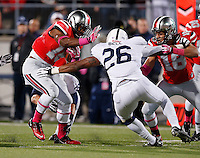 Ohio State Buckeyes running back Ezekiel Elliott (15) rushes toward the end zone and Penn State Nittany Lions linebacker Brandon Bell (26) during the second half of the NCAA football game at Ohio Stadium in Columbus on Oct. 26, 2013. (Adam Cairns / The Columbus Dispatch)