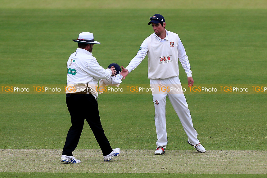 Alastair Cook of Essex takes a cap from umpire Paul Baldwin as bad light stops play during Middlesex CCC vs Essex CCC, Specsavers County Championship Division 1 Cricket at Lord's Cricket Ground on 21st April 2017