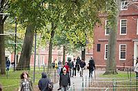 People walk through Harvard Yard at Harvard University in Cambridge, Massachusetts, USA, on Mon., Oct 15, 2018.