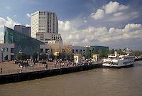 skyline, New Orleans, Louisiana, LA, View of the Aquarium of the Americas and downtown skyline of New Orleans along the Mississippi River. Passenger ferry along the riverfront.