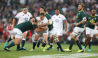 George Ford of England tackled by Franco Mostert of South Africa during the 2018 Castle Lager Incoming Series 1st Test match between South Africa and England at Emirates Airline Park,<br /> Johannesburg.South Africa. 09,06,2018 Photo by (Steve Haag Sports)