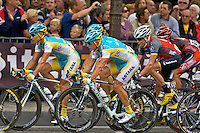 Maxim Iglinskiy (left) and team mate Alexandre Vinokourov (right) protect their lead rider Alberto Contador during the last lap of the Champs Elysees on 25th July 2010, Paris, France