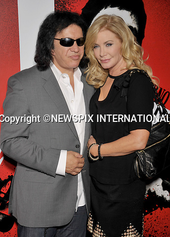 "GENE SIMMONS AND SHANNON TWEED.attends the launch of ""Scarface"" on Blu-Ray at the Belasco Theater, Los Angeles_23/08/2011.Mandatory Photo Credit: ©Crosby/Newspix International. .**ALL FEES PAYABLE TO: ""NEWSPIX INTERNATIONAL""**..PHOTO CREDIT MANDATORY!!: NEWSPIX INTERNATIONAL(Failure to credit will incur a surcharge of 100% of reproduction fees).IMMEDIATE CONFIRMATION OF USAGE REQUIRED:.Newspix International, 31 Chinnery Hill, Bishop's Stortford, ENGLAND CM23 3PS.Tel:+441279 324672  ; Fax: +441279656877.Mobile:  0777568 1153.e-mail: info@newspixinternational.co.uk"