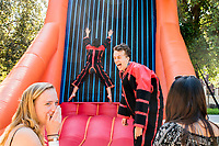Students enjoy the crazy antics of Occidental's Spring Fest Pre-Show on April 1, 2017, hours before T-Pain performs in the Greek Bowl. Activities include live music by students and KOXY, a bounce house, velcro wall, food trucks, boba, and beer garden. <br /> <br /> (Photo by Nick Harrington, Occidental College Class of 2017)
