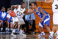 25 February 2010:  FIU's Marvin Roberts (11) is defended by MTSU's Calvin O'Neil (4) in the first half as the Middle Tennessee Blue Raiders defeated the FIU Golden Panthers, 74-71, at the U.S. Century Bank Arena in Miami, Florida.