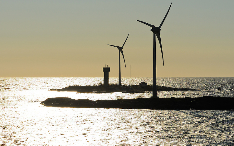 Wind turbines are new additions to the islets of Nyhamn Lighthouse, Äland, Finland.