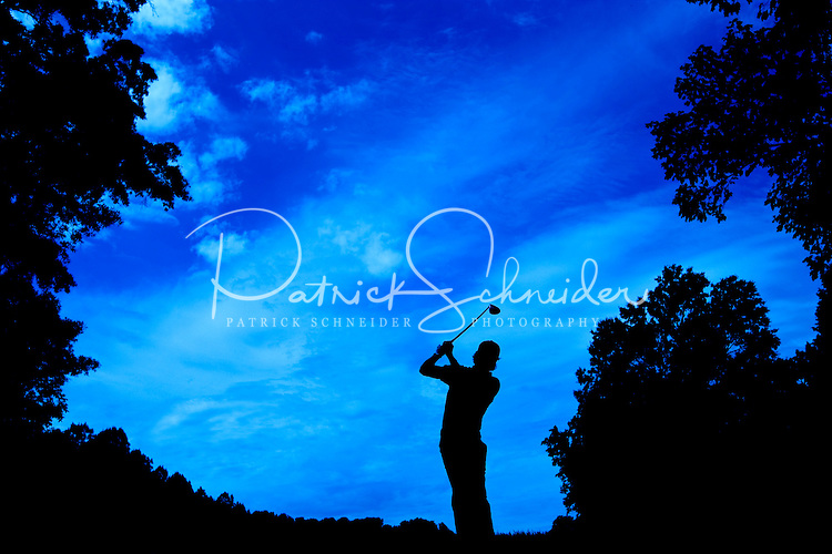 Golfer Camilo Villegas is silhouetted against a Carolina blue sky during the Quail Hollow Championship golf tournament 2009. The event, formerly called the Wachovia Championship, is a top event on the PGA Tour, attracting such popular golf icons as Tiger Woods, Vijay Singh and Bubba Watson. The third round in the Quail Hollow Championship golf tournament at the Quail Hollow Club in Charlotte, N.C., Saturday, May 02, 2009.