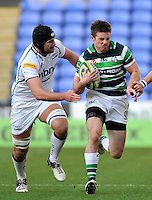 Reading, England. Conor Gaston of London Irish in action during the LV= Cup match between London Irish and Sale Sharks at Madejski Stadium on November 11, 2012 in Reading, England.
