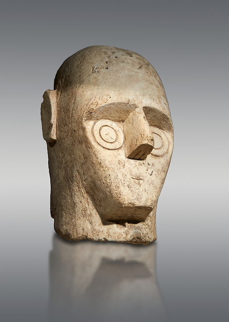 9th century BC Giants of Mont'e Prama Nuragic stone head from the statue of a boxer, Mont'e Prama archaeological site, Cabras. Museo archeologico nazionale, Cagliari, Italy. (National Archaeological Museum) - Grey Background