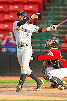 Angelo Gumbs #21 of the Charleston RiverDogs follows through on his swing against the Hickory Crawdads at L.P. Frans Stadium on April 29, 2012 in Hickory, North Carolina.  The Crawdads defeated the RiverDogs 12-3.  (Brian Westerholt/Four Seam Images)