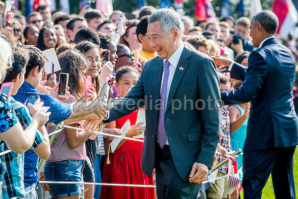 Prime Minister Lee Hsien Loong of Singapore greets guests during official welcoming ceremonies on the South Lawn of the White House in Washington, DC on August 2, 2016. Lee is on a State Visit to the United States. Photo Credit: Pete Marovich/CNP/AdMedia