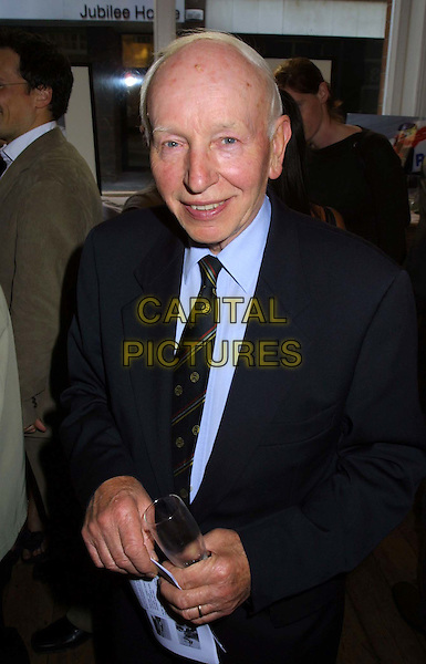 JOHN SURTEES.Speed Exhibition at Getty Images Gallery.www.capitalpictures.com.sales@capitalpictures.com.© Capital Pictures.half length, half-length.