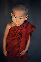 Buddhist monk, Yangon, Burma/Myanmar 2005.<br /> In the Therevada Buddhist tradition a family earns great merit when one of their sons takes up robes and a begging bowl to become one of the country&rsquo;s two million monks.