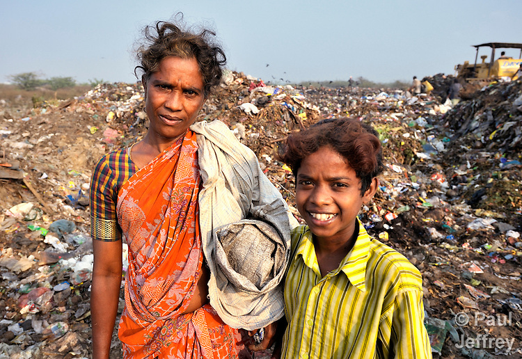 A boy and his mother both scavenge for recyclable items in the smoldering municipal garbage dump in Chennai, India. This boy spends his nights in a shelter sponsored by the Madras Christian Council of Social Service.