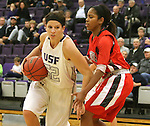 SIOUX FALLS, SD - DECEMBER 8:  Alison Klostergaard #52 from the University of Sioux Falls looks to make a move against Kanesha Woods #22 from Minot State Friday night at the Stewart Center.(Photo by Dave Eggen/Inertia)