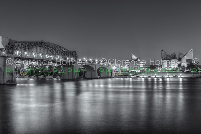 The Chief John Ross (Market Street) bridge and Tennessee Aquarium on the Tennessee River at twilight in Chattanooga, Tennessee.