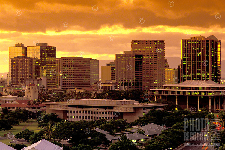 Downtown Honolulu skyline at sunset. The State Capitol is in the right middleground