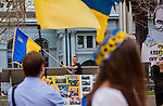 An unidentified young man waves the Ukrainian flag at the Ukrainian rally in Justin Herman Plaza, in San Francisco, California, on Sunday, March 9th, 2014.  Photo/Victoria Sheridan