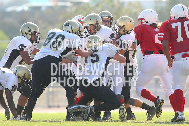 Lawndale, CA 09/29/11 - Garrett Nelsen (Peninsula #88), David Odusanya (Peninsula #45), Michael Pettis (Peninsula #75) in action during the Peninsula - Lawndale Junior Varsity Football game.
