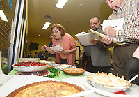 NWA Democrat-Gazette/FLIP PUTTHOFF<br />PIE TIMES TASTE BUDS SQUARED<br />Pie judges Kathy Turner (from left), Lowell Mayor Eldon Long and Gary Turner judge home-made pie on Wednesday Feb. 28 2018 during a pie-baking pie contest at the Lowell Senior Activity Center. Judges scored 16 home-baked pies submitted by center patrons on a variety of criteria. Slices of pie were sold after the contest to raise money for the center, said Stefanie Jackson with the Office of Human Concern in Rogers. Diana Osborn (cq) of Springdale won the contest with a cherry cheese pie she baked.