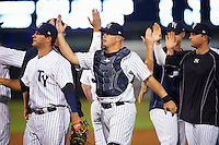 Tampa Yankees catcher Wes Wilson (6) high fives teammates after a game against the Bradenton Marauders on April 11, 2016 at George M. Steinbrenner Field in Tampa, Florida.  Tampa defeated Bradenton 5-2.  (Mike Janes/Four Seam Images)