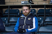Stuart Sinclair of Bristol Rovers sits in the stand during the Sky Bet League 2 match between Wycombe Wanderers and Bristol Rovers at Adams Park, High Wycombe, England on 27 February 2016. Photo by Andy Rowland.