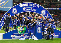 01.03.2015.  London, England. Capital One Cup Final. Chelsea versus Tottenham Hotspur. The Chelsea team celebrate their victory with José Mourinho, the Chelsea manager sticking his tongue out.